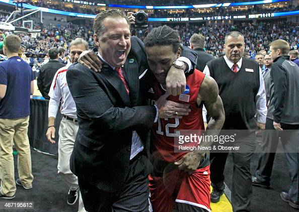 North Carolina State head coach Mark Gottfried celebrates with Cat Barber after NC State's 7168 victory against Villanova in the third round NCAA...