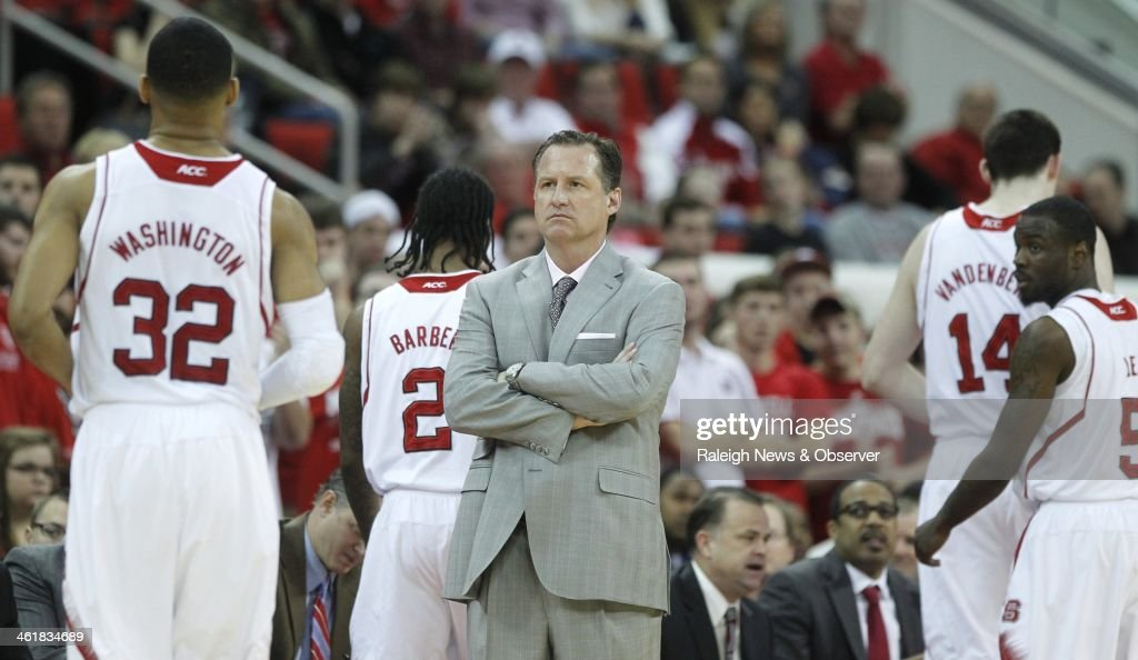 North Carolina State head coach Mark Gottfried watches as four of the five starters come off the court early in the first half against Virginia at PNC Arena in Raleigh, N.C., on Saturday, Jan. 11, 2014.