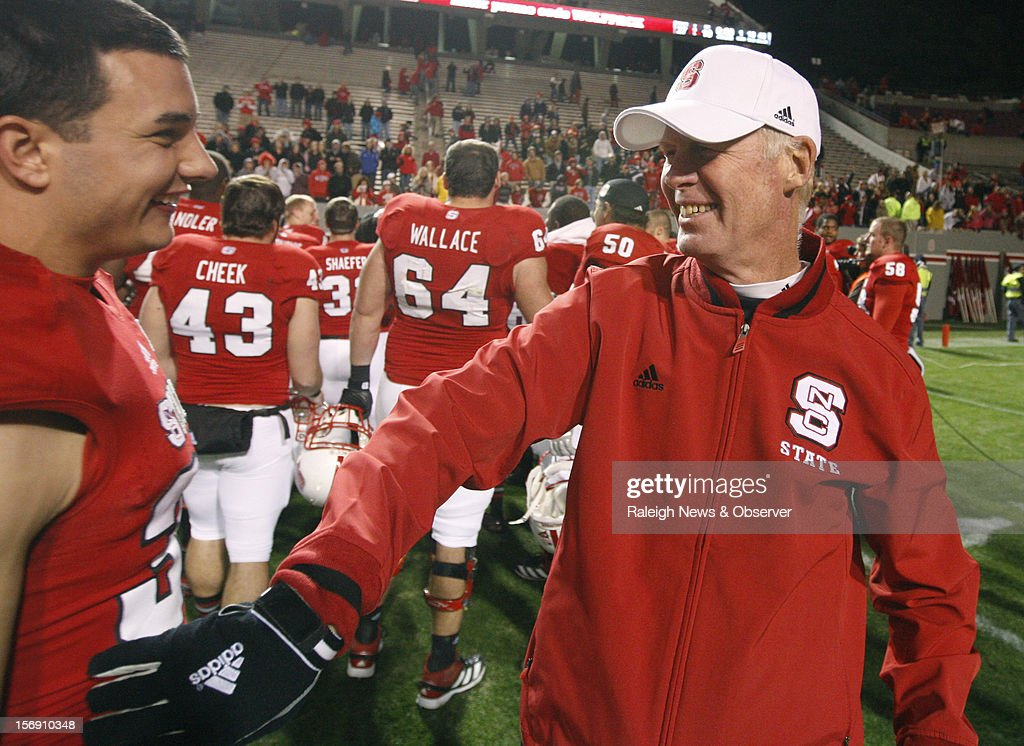 North Carolina State head coach Tom O'Brien laughs with senior Brandan Bishop, left, after the Wolfpack's 27-10 victory over Boston College on Saturday, November 24, 2012, at Carter-Finley Stadium in Raleigh, North Carolina.
