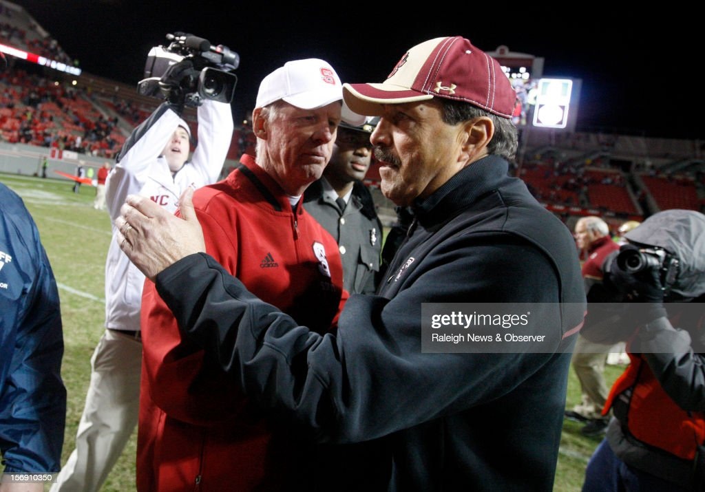 North Carolina State head coach Tom O'Brien shakes hands with Boston College's head coach Frank Spaziani, right, after the Wolfpack's 27-10 victory over Boston College on Saturday, November 24, 2012, at Carter-Finley Stadium in Raleigh, North Carolina.