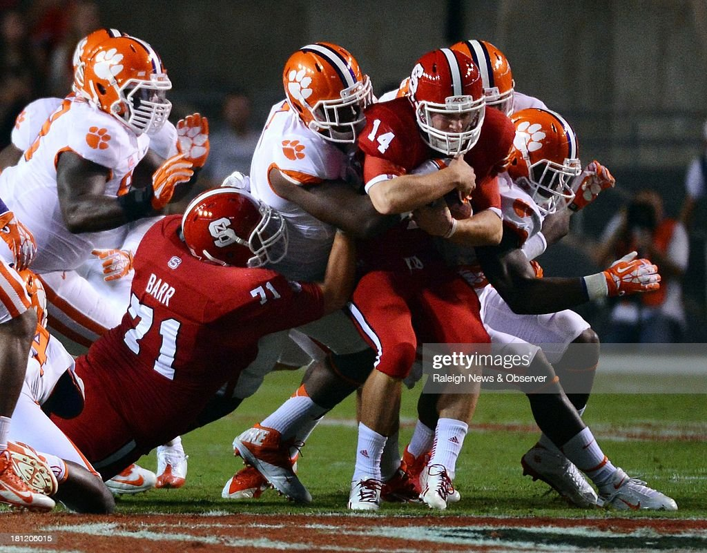 North Carolina State quarterback Bryant Shirreffs (14) is stacked up by the Clemson defense in the first quarter on Thursday, September 19, 2013, at Carter-Finley Stadium in Raleigh, North Carolina. Clemson won, 26-14.