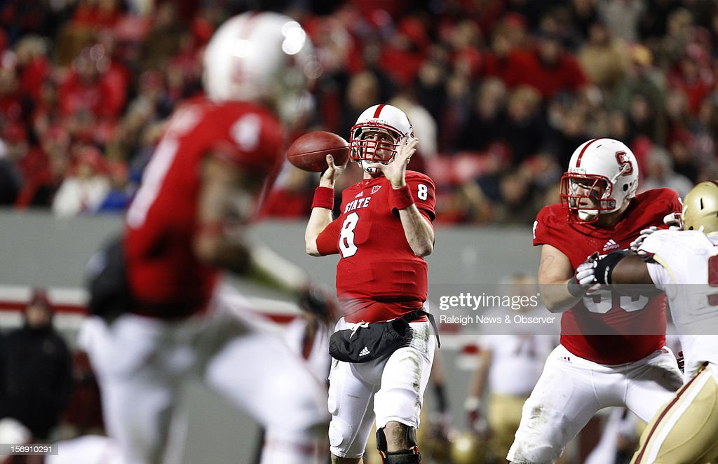 North Carolina State quarterback Mike Glennon (8) passes to wide receiver Tobais Palmer (4), left, for 25-yard touchdown reception during the second half of a 27-10 victory over Boston College on Saturday, November 24, 2012, at Carter-Finley Stadium in Raleigh, North Carolina.