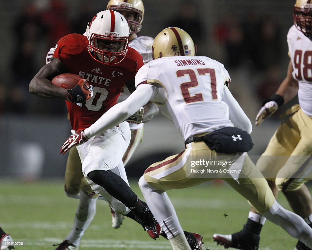 North Carolina State running back Shadrach Thornton (10) is confronted by Boston College defensive back Justin Simmons (27) during the second half on Saturday, November 24, 2012, at Carter-Finley Stadium in Raleigh, North Carolina. N.C. State won, 27-10.