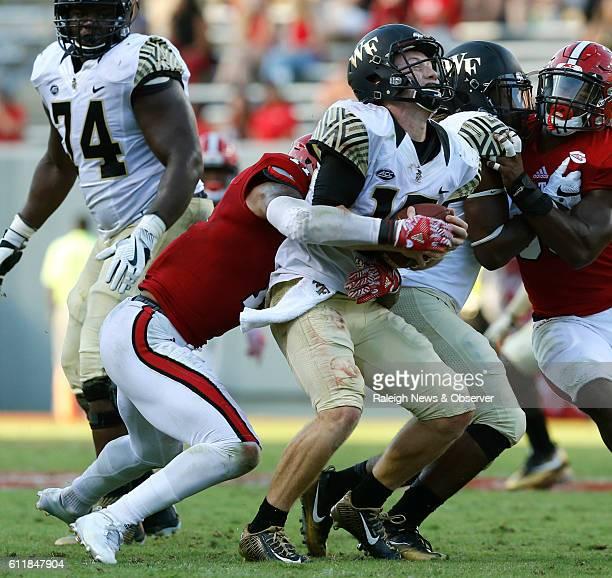 North Carolina State safety Josh Jones left sacks Wake Forest quarterback John Wolford during the second half at CarterFinley Stadium in Raleigh NC...