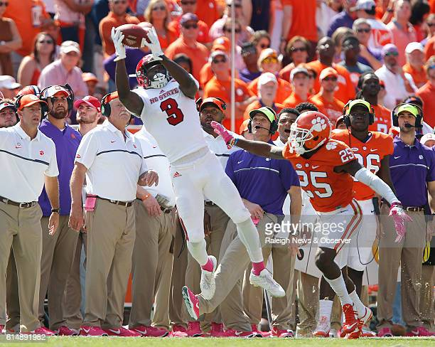 North Carolina State wide receiver Kelvin Harmon pulls in a reception as Clemson cornerback Cordrea Tankersley defends during the first half at...
