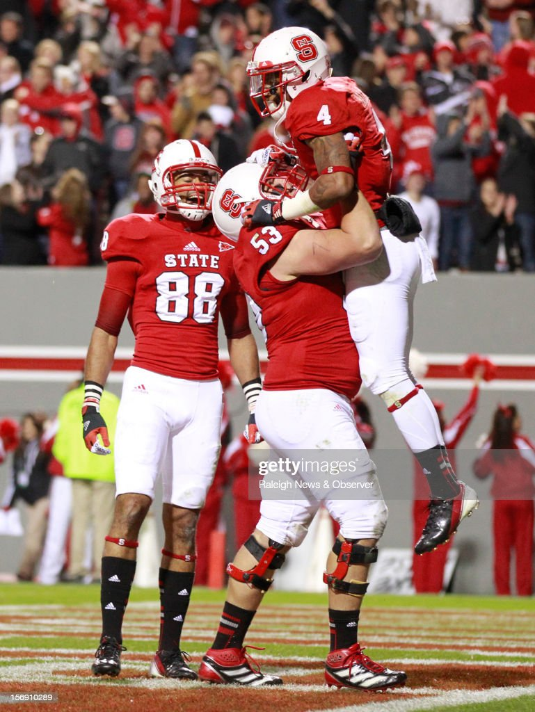 North Carolina State wide receiver Quintin Payton (88) and center Camden Wentz (53) celebrate with wide receiver Tobais Palmer (4) after Palmer pulled in an 8-yard touchdown reception during the second half of a 27-10 victory over Boston College on Saturday, November 24, 2012, at Carter-Finley Stadium in Raleigh, North Carolina.