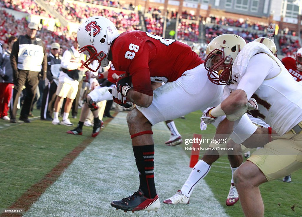 North Carolina State wide receiver Quintin Payton (88) pulls in a 4-yard touchdown reception as Boston College's Spenser Rositano (47) defends during the first half on Saturday, November 24, 2012, at Carter-Finley Stadium in Raleigh, North Carolina.