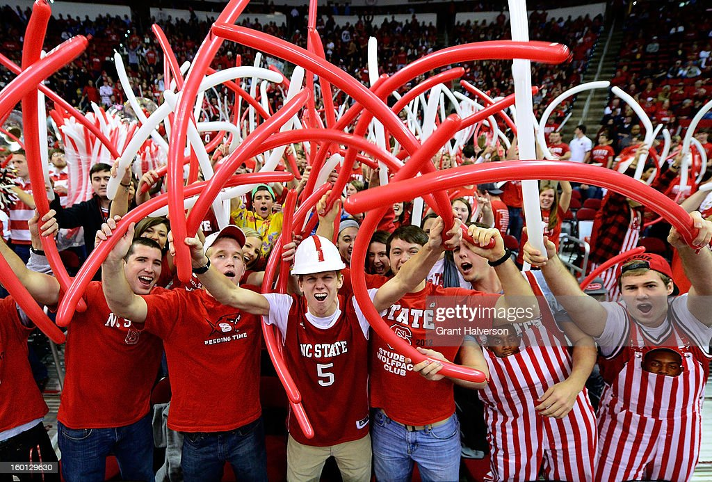 North Carolina State Wolfpack fans cheer during a win over the North Carolina Tar Heels during play at PNC Arena on January 26, 2013 in Raleigh, North Carolina.