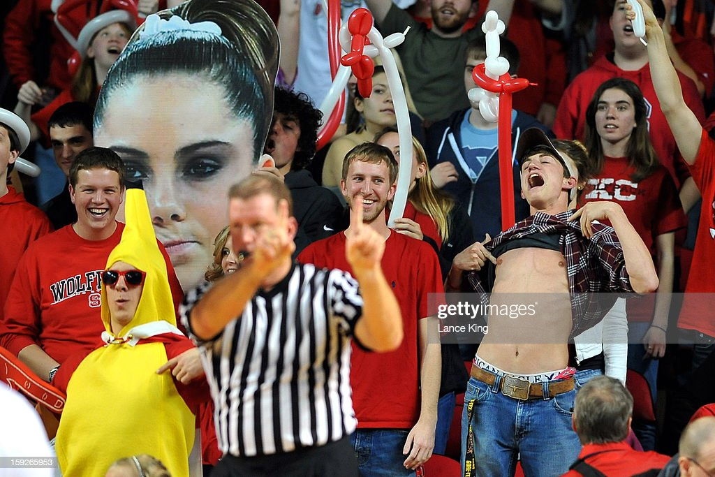 North Carolina State Wolfpack fans try to distract players of North Carolina Tar Heels at Reynolds Coliseum on January 10, 2013 in Raleigh, North Carolina. North Carolina defeated NC State 70-66.