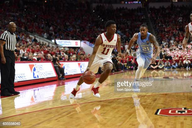 North Carolina State Wolfpack guard Markell Johnson drives around North Carolina Tar Heels guard Seventh Woods during a game between the North...