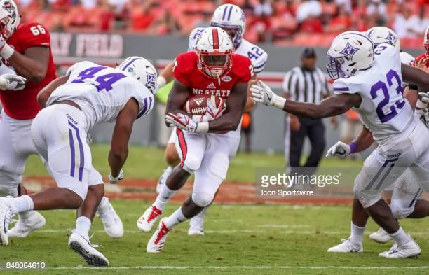 North Carolina State Wolfpack running back Dakwa Nichols protects the ball on a run during the NCAA football game between the North Carolina State...