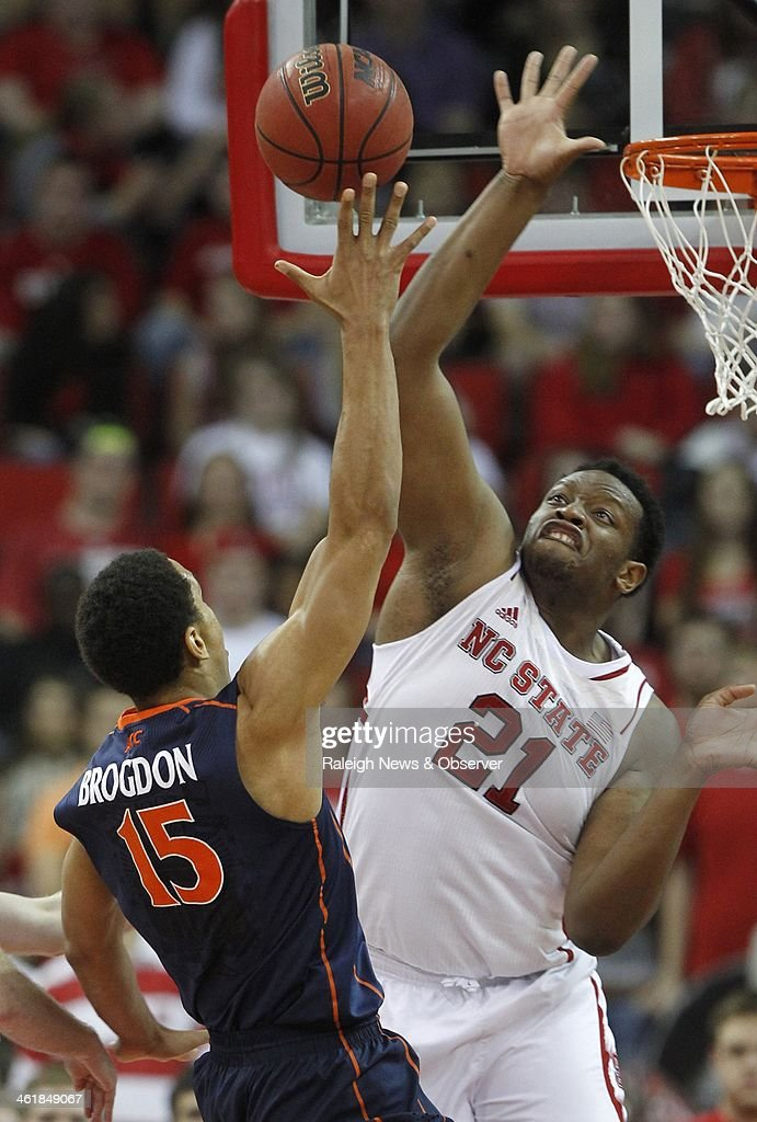 North Carolina State's Beejay Anya (21) blocks the shot of Virginia's Malcolm Brogdon (15) during the second half at PNC Arena in Raleigh, N.C., on Saturday, Jan. 11, 2014. Virginia rolled, 76-45.