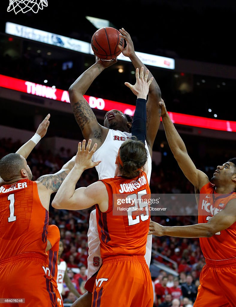 North Carolina State's Beejay Anya (21) shoots while defended by Virginia Tech's Malik Muller (1), Will Johnston (25) and Jalen Hudson (23) during the second half at PNC Arena in Raleigh, N.C., on Saturday, Feb. 21, 2015. The host Wolfpack won, 69-53.