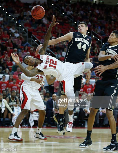 North Carolina State's Cat Barber goes flying after being fouled as Wake Forest's Konstantinos Mitoglou and Andre Washington defend during the first...