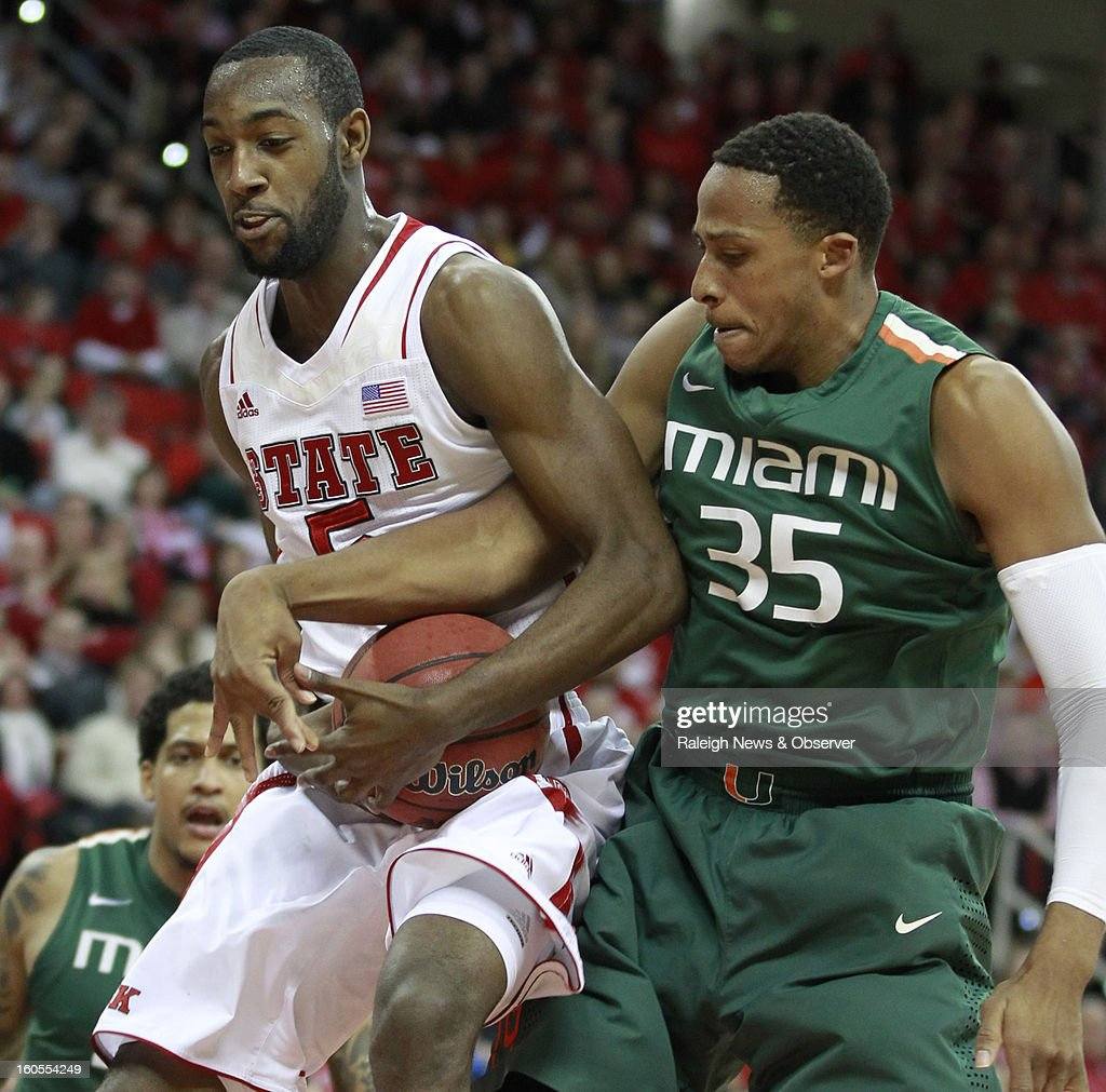 North Carolina State's C.J. Leslie (5) and Miami's Kenny Kadji (35) fight for the rebound during the first half at PNC Arena in Raleigh, North Carolina, on Saturday, February 2, 2013.