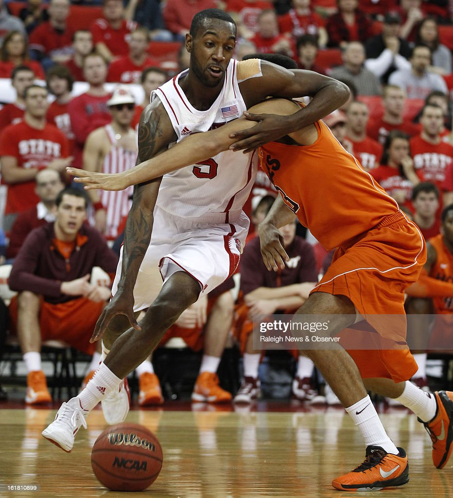 North Carolina State's C.J. Leslie (5) drives around Virginia Tech's Marshall Wood (33) in the first half at PNC Arena in Raleigh, North Carolina, Saturday, February 16, 2013. N.C. State defeated Virginia Tech in overtime, 90-86.