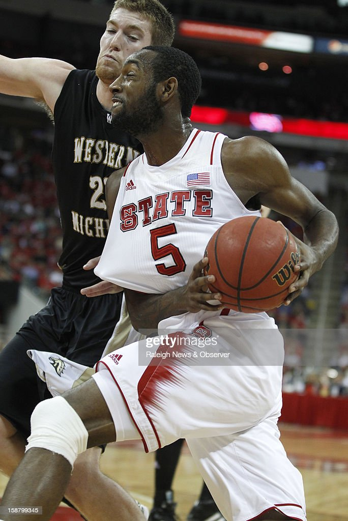 North Carolina State's C.J. Leslie (5) drives past Western Michigan's Shayne Whittington (21) in the second half at PNC Arena in Raleigh, North Carolina, Saturday, December 29, 2012. N.C. State defeated Western Michigan, 84-68.