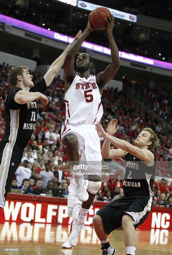 North Carolina State's C.J. Leslie (5) drives to the basket, past Western Michigan's Nate Hutcheson (11), left, and Connar Tava (2) in the second half at PNC Arena in Raleigh, North Carolina, Saturday, December 29, 2012. N.C. State defeated Western Michigan, 84-68.