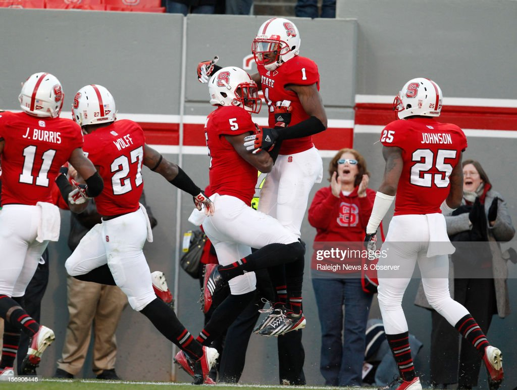 North Carolina State's David Amerson (1) celebrates with teammate Rodman Noel (5) after taking an interception in for a touchdown during the first half against Boston College on Saturday, November 24, 2012, at Carter-Finley Stadium in Raleigh, North Carolina.