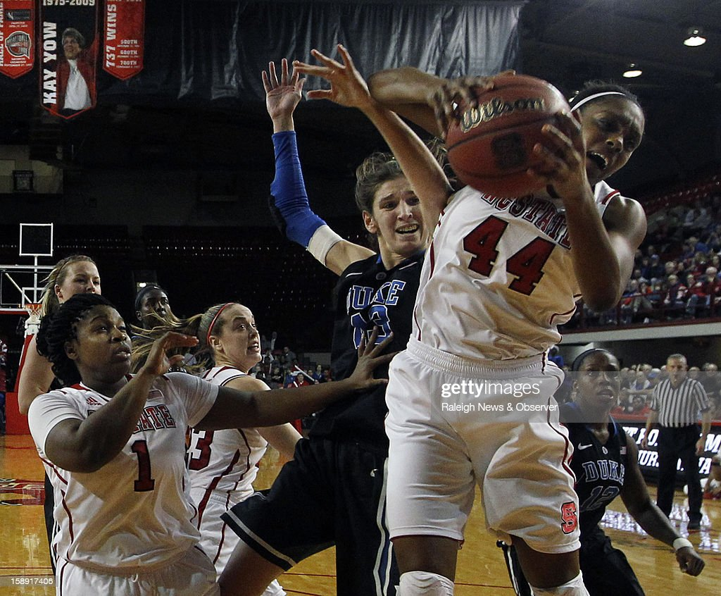 North Carolina State's Kody Burke (44) wrestles a first-half rebound from Duke's Allison Vernerey at Reynolds Coliseum in Raleigh, North Carolina, on Thursday January 3, 2013.