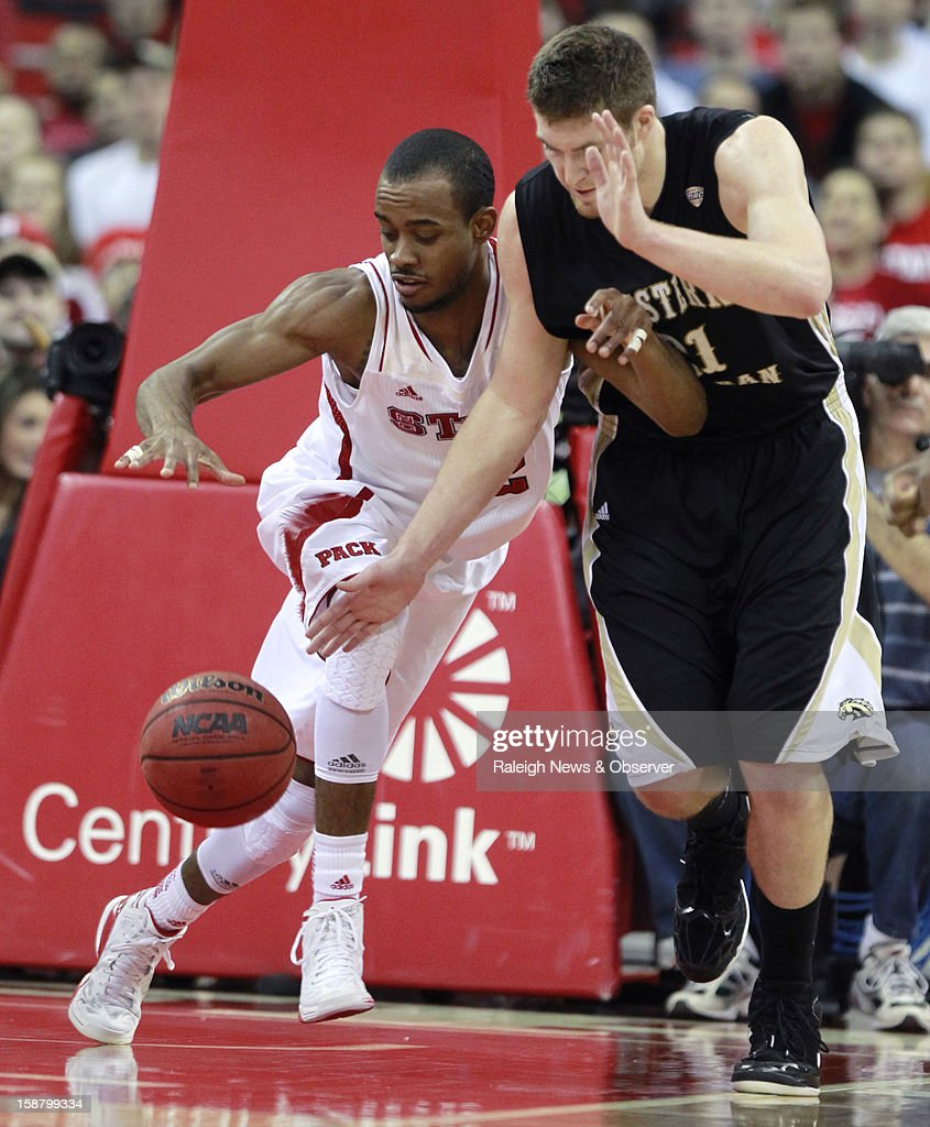 North Carolina State's Lorenzo Brown (2) keeps the ball away from Western Michigan's Shayne Whittington (21) during the first half at PNC Arena in Raleigh, North Carolina, Saturday, December 29, 2012. N.C. State defeated Western Michigan, 84-68.