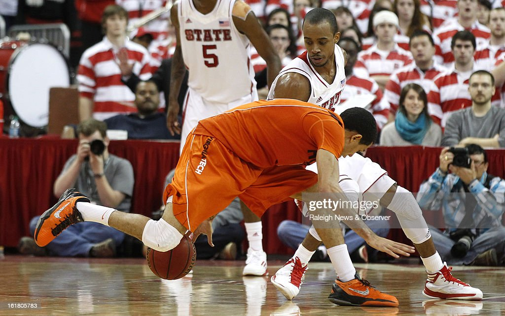 North Carolina State's Lorenzo Brown (2),right, steals the ball from Virginia Tech's Erick Green (11) with less than 20 seconds left in overtime at PNC Arena in Raleigh, North Carolina, Saturday, February 16, 2013. N.C. State defeated Virginia Tech in overtime, 90-86.