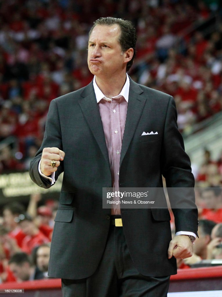 North Carolina State's Mark Gottfried is pumped during the second half of a 91-83 victory over North Carolina on Saturday, January 26, 2013, at the PNC Arena in Raleigh, North Carolina.