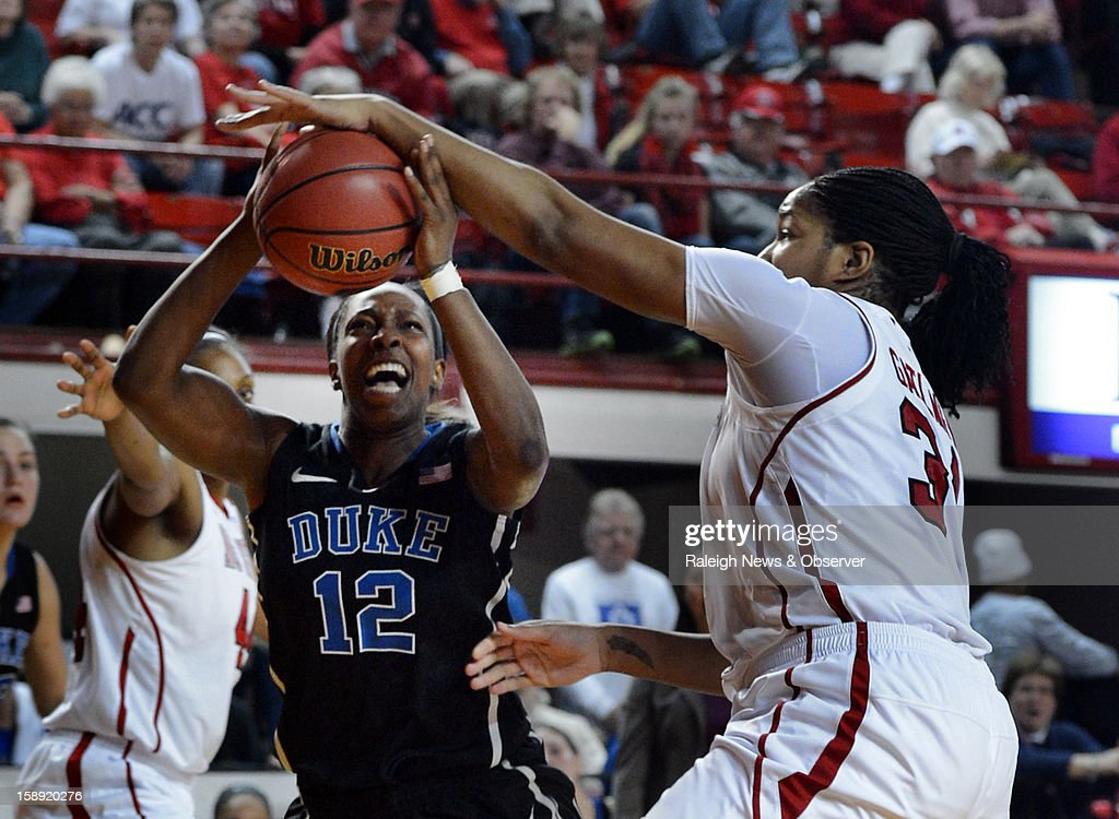 North Carolina State's Markeisha Gatling (34) is called for a foul on this drive by Duke's Chelsea Gray (12) in the second half at Reynolds Coliseum in Raleigh, North Carolina, on Thursday, January 3, 2013. Duke won, 67-57.