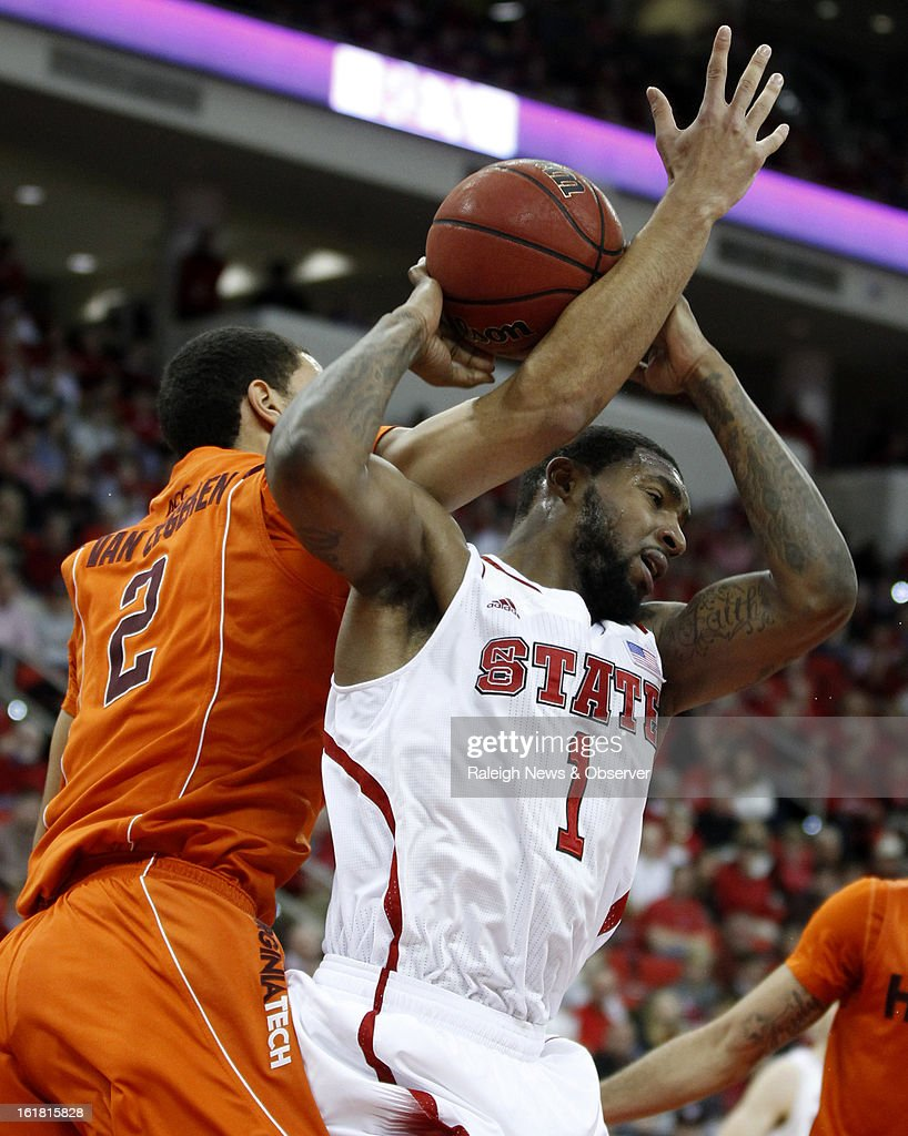 North Carolina State's Richard Howell (1) pulls in a rebound while battling with Virginia Tech's Joey Van Zegeren (2) in the second half at PNC Arena in Raleigh, North Carolina, Saturday, February 16, 2013. N.C. State defeated Virginia Tech in overtime, 90-86.
