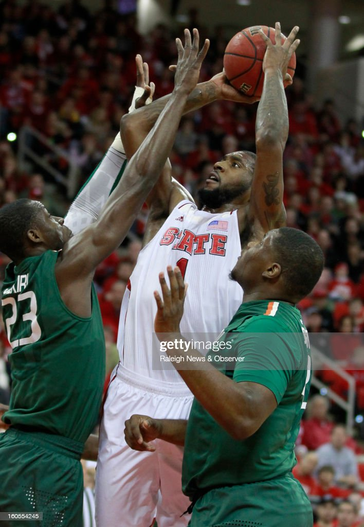 North Carolina State's Richard Howell shoots between Miami's Tonye Jekiri (23) and Reggie Johnson, right, during the first half at PNC Arena in Raleigh, North Carolina, on Saturday, February 2, 2013.