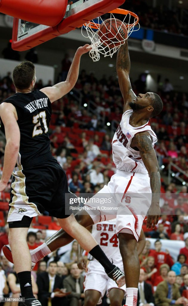 North Carolina State's Richard Howell (1) slams in two past Western Michigan's Shayne Whittington (21) in the first half at PNC Arena in Raleigh, North Carolina, Saturday, December 29, 2012. N.C. State defeated Western Michigan, 84-68.