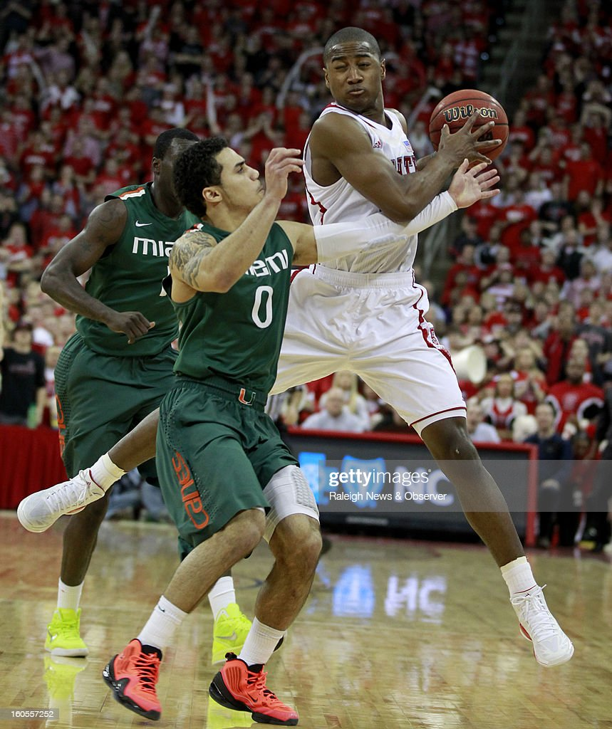 North Carolina State's Rodney Purvis pulls in the ball as Miami's Shane Larkin (0) defends during the second half of Miami's 79-78 victory at PNC Arena in Raleigh, North Carolina, on Saturday, February 2, 2013.