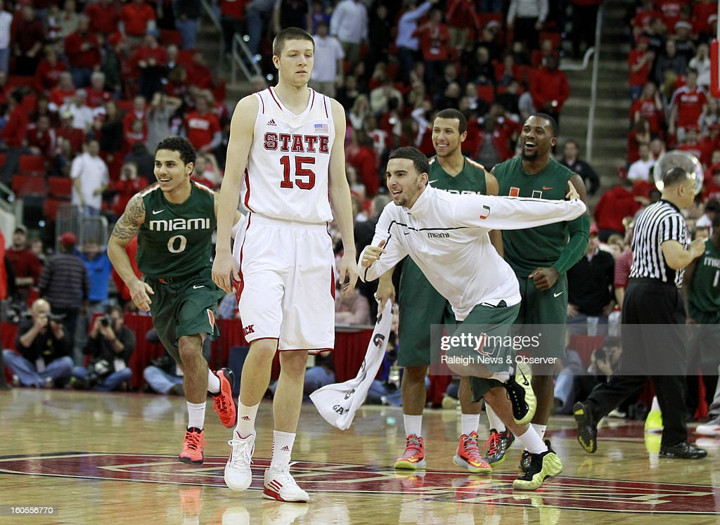 North Carolina State's Scott Wood (15) walks off the floor as Miami celebrates a 79-78 victory at PNC Arena in Raleigh, North Carolina, on Saturday, February 2, 2013.