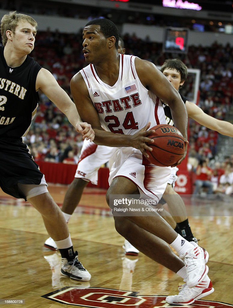 North Carolina State's T.J. Warren (24) drives past Western Michigan's Connar Tava (2) in the second half at PNC Arena in Raleigh, North Carolina, Saturday, December 29, 2012. N.C. State defeated Western Michigan, 84-68.