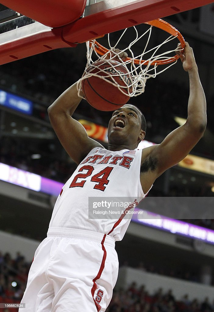 North Carolina State's T.J. Warren (24) dunks during the second half of an 82-80 victory over UNC-Asheville at the PNC Arena in Raleigh, North Carolina, on Friday, November 23, 2012.