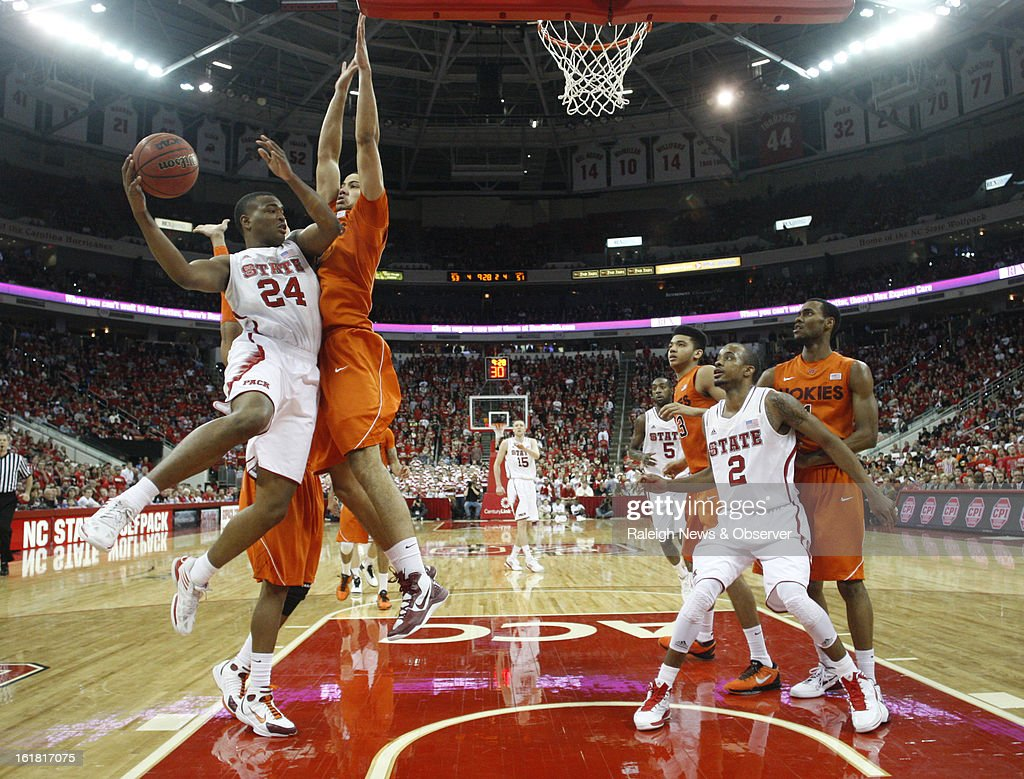 North Carolina State's T.J. Warren (24) gets ready to pass the ball to Lorenzo Brown (2) in the second half against Virginia Tech at PNC Arena in Raleigh, North Carolina, Saturday, February 16, 2013. N.C. State defeated Virginia Tech in overtime, 90-86.