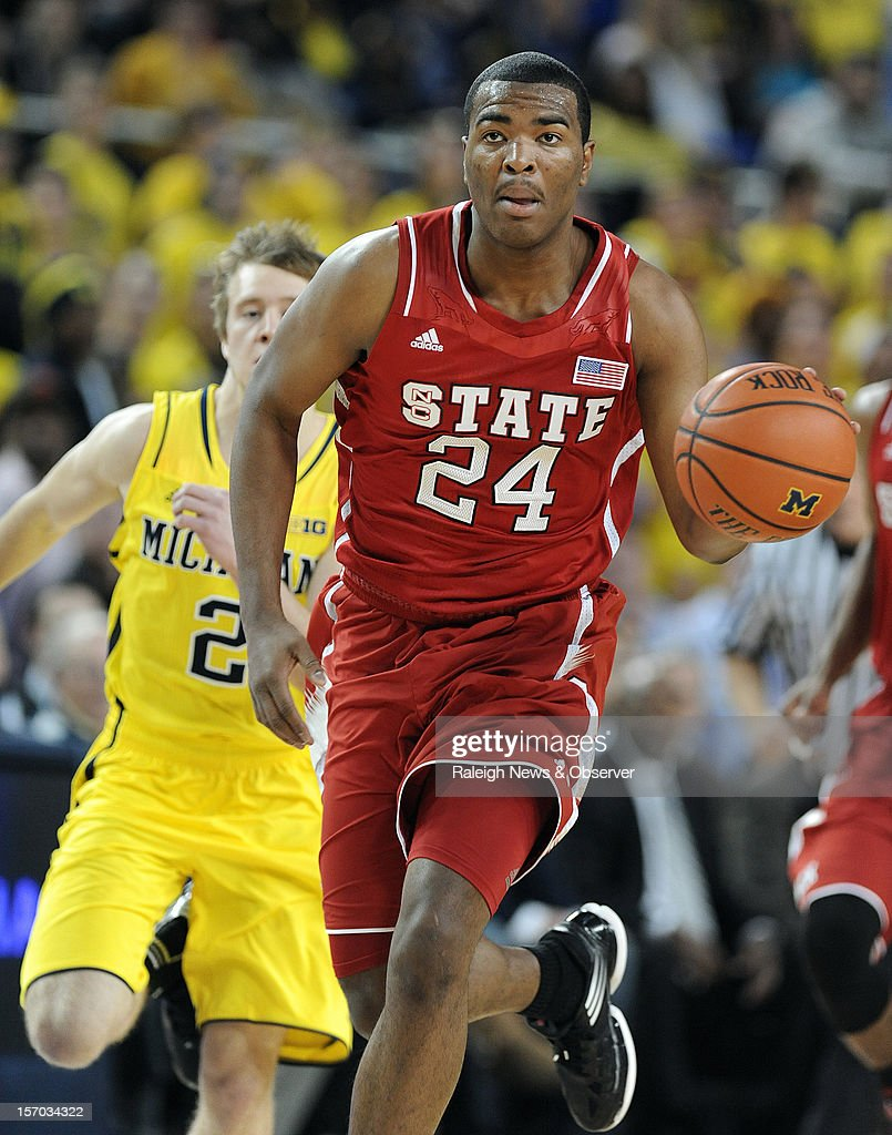 North Carolina State's T.J. Warren hustles the ball up the floor during a first-half fast break against the Michigan Wolverines at the Crisler Center on Tuesday, November 27, 2012, in Ann Arbor, Michigan.