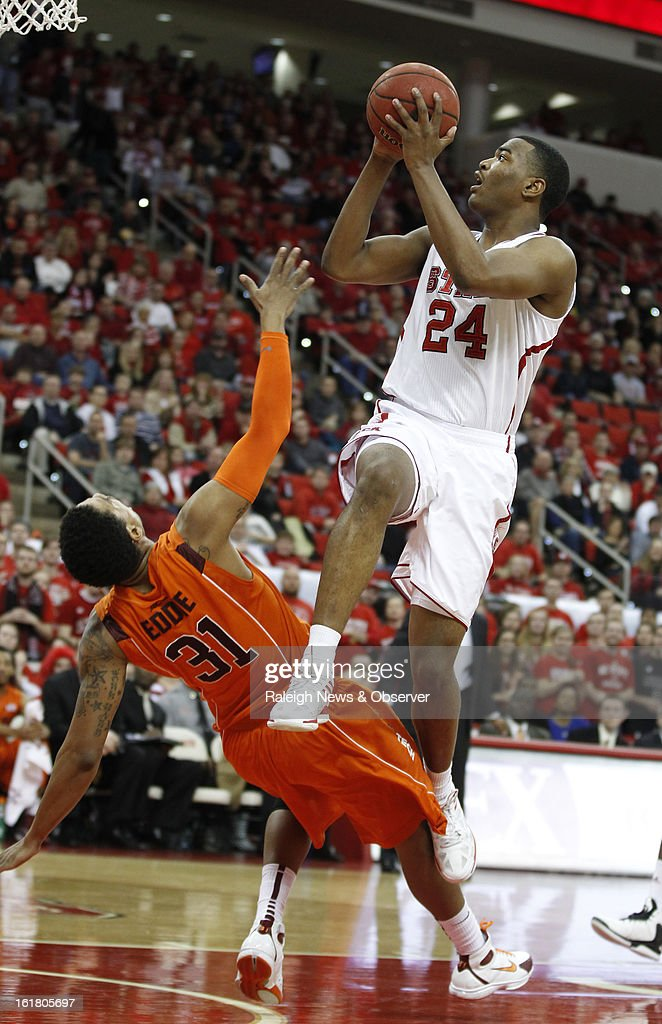 North Carolina State's T.J. Warren (24) is fouled by Virginia Tech's Jarell Eddie (31) during the first half at PNC Arena in Raleigh, North Carolina, Saturday, February 16, 2013. N.C. State defeated Virginia Tech in overtime, 90-86.