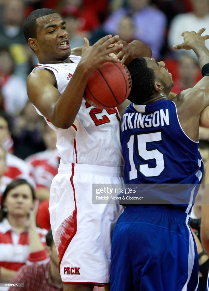 North Carolina State's T.J. Warren (24) pulls in a rebound over UNC-Asheville's Jeremy Atkinson (15) during the second half at the PNC Arena in Raleigh, North Carolina, on Friday, November 23, 2012. N.C. State won, 82-80.