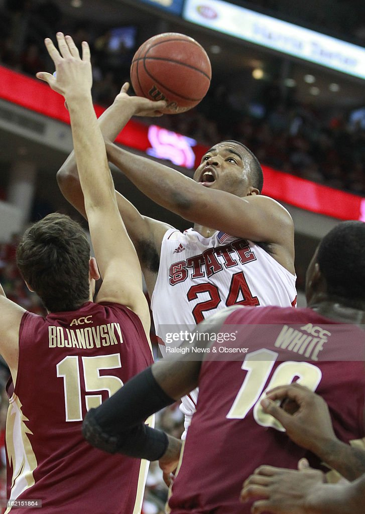 North Carolina State's T.J. Warren (24) shoots as Florida State's Boris Bojanovsky (15) defends during the second half of N.C. State's 84-66 victory on Tuesday, February 19, 2013, at PNC Arena in Raleigh, North Carolina.