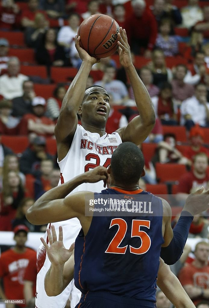 North Carolina State's T.J. Warren (24) shoots over Virginia's Akil Mitchell (25) during the first half at PNC Arena in Raleigh, N.C., on Saturday, Jan. 11, 2014.
