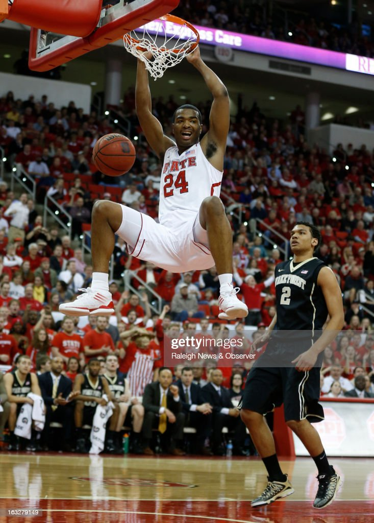 North Carolina State's T.J. Warren (24) slams in two as Wake Forest's Devin Thomas (2) watches during the first half at PNC Arena in Raleigh, North Carolina, on Wednesday, March 6, 2013.
