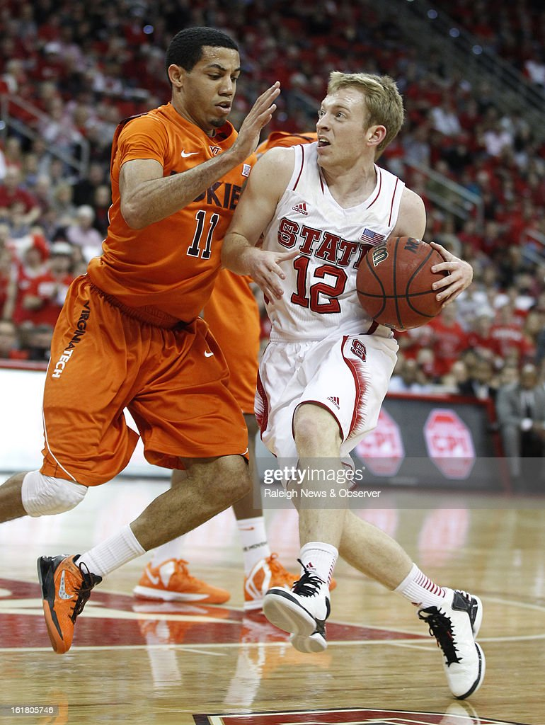 North Carolina State's Tyler Lewis (12) drives around Virginia Tech's Erick Green (11) during the first half at PNC Arena in Raleigh, North Carolina, Saturday, February 16, 2013. N.C. State defeated Virginia Tech in overtime, 90-86.