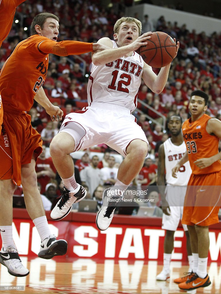 North Carolina State's Tyler Lewis (12) is fouled by Virginia Tech's Will Johnston (25) in the second half at PNC Arena in Raleigh, North Carolina, Saturday, February 16, 2013. N.C. State defeated Virginia Tech in overtime, 90-86.