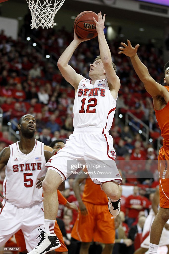 North Carolina State's Tyler Lewis (12) shoots during the first half against Virginia Tech at PNC Arena in Raleigh, North Carolina, Saturday, February 16, 2013. N.C. State defeated Virginia Tech in overtime, 90-86.