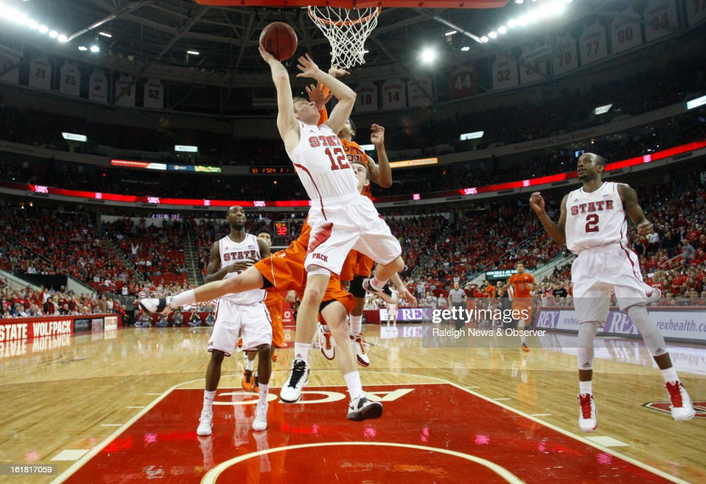 North Carolina State's Tyler Lewis (12) shoots in overtime against Virginia Tech at PNC Arena in Raleigh, North Carolina, Saturday, February 16, 2013. N.C. State defeated Virginia Tech, 90-86.