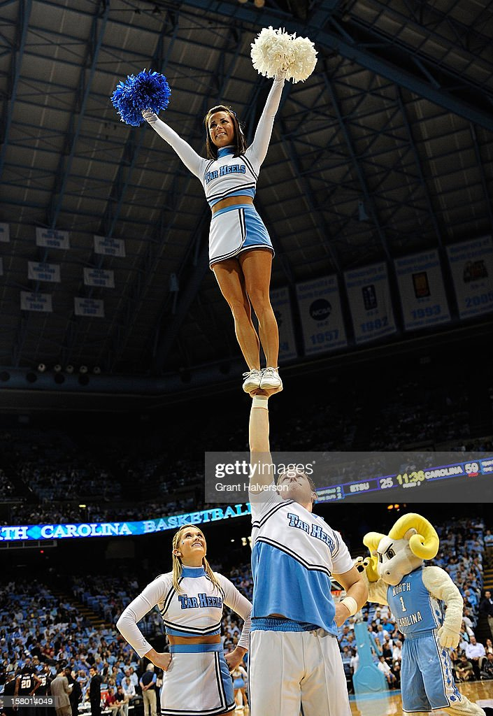 North Carolina Tar Heels cheerleaders perform during a game against the East Tennessee State Buccaneers at the Dean Smith Center on December 8, 2012 in Chapel Hill, North Carolina. North Carolina won 78-55.
