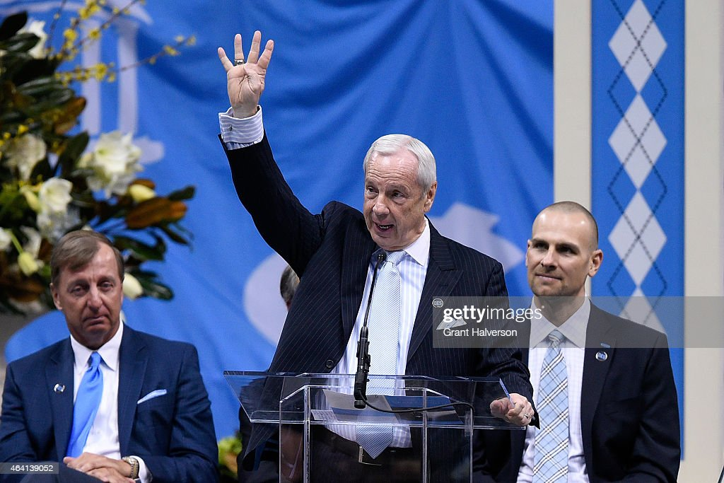 North Carolina Tar Heels coach Roy Williams shows Dean Smith's famous four corners symbol during a memorial service at the Dean Smith Center on February 22, 2015 in Chapel Hill, North Carolina.