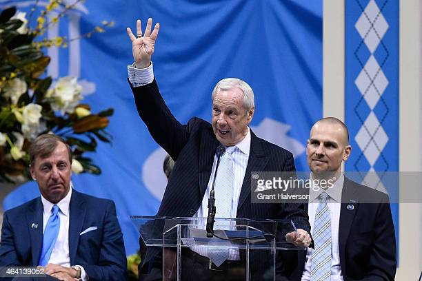 North Carolina Tar Heels coach Roy Williams shows Dean Smith's famous four corners symbol during a memorial service at the Dean Smith Center on...