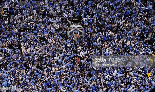 North Carolina Tar Heels fans storm the court after a win over the Duke Blue Devils during their game at the Dean Smith Center on February 20 2014 in...